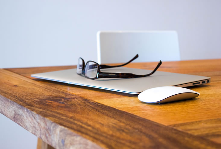 MacBook, mouse and glasses